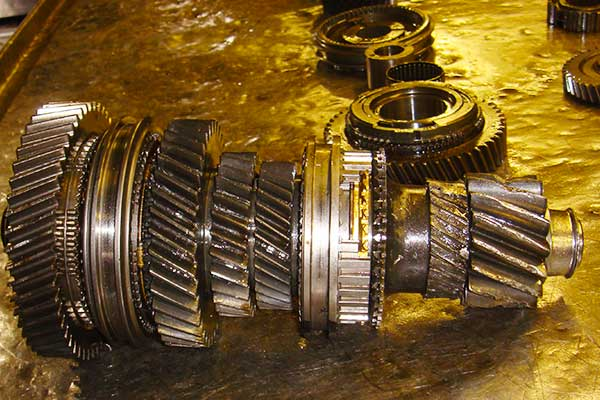 close up view of a gearbox main shaft with almost all the teeth damaged