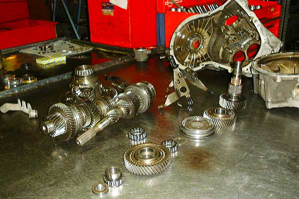 close up view of a fully dismantled gearbox including casin gears shafts and bearings